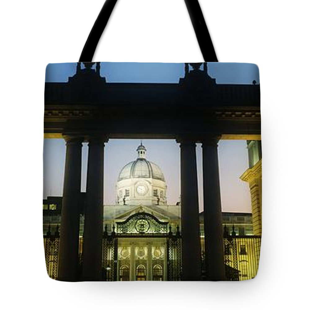 Architecture Tote Bag featuring the photograph Facade Of A Government Building Lit Up by The Irish Image Collection