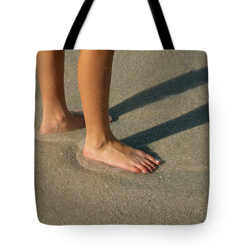 Shadows Tote Bag featuring the photograph Feet In The Wet Sand Of A Beach Wait by Paul Damien