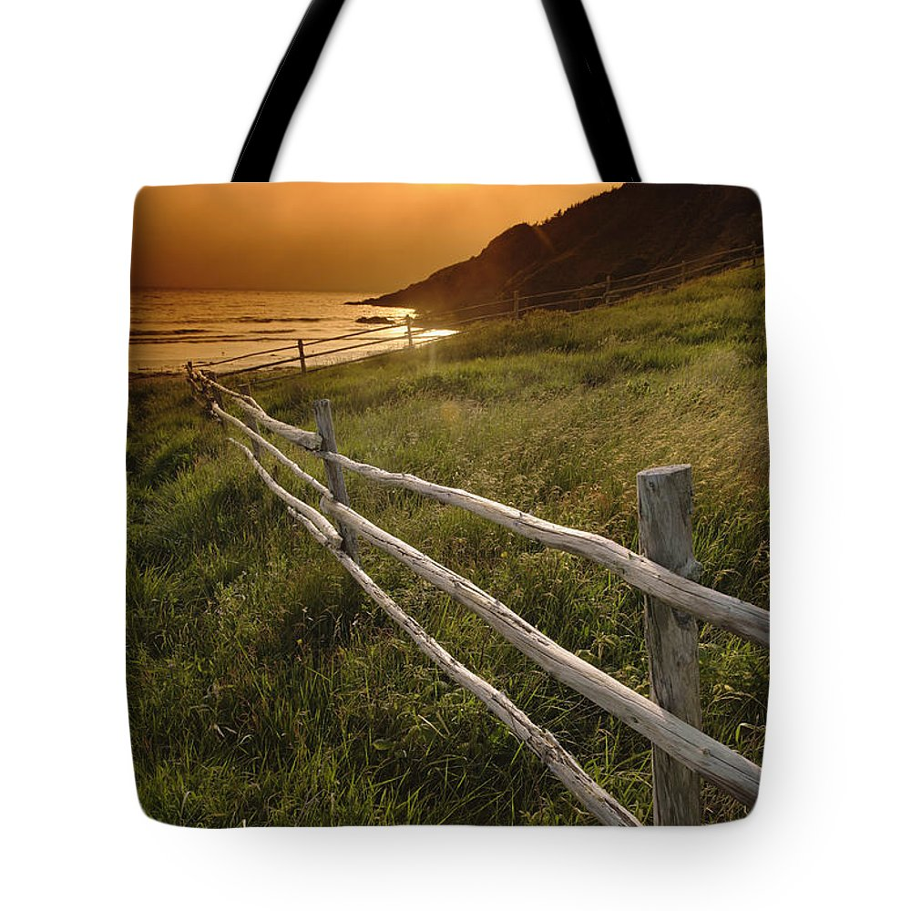 Dusk Tote Bag featuring the photograph Fence And Sunset, Gooseberry Cove by Yves Marcoux