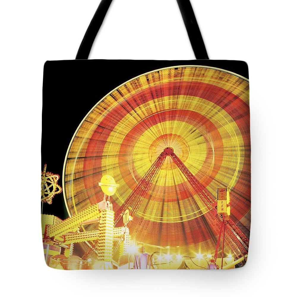 Amusement Park Tote Bag featuring the photograph Ferris Wheel And Other Rides, Derry by The Irish Image Collection