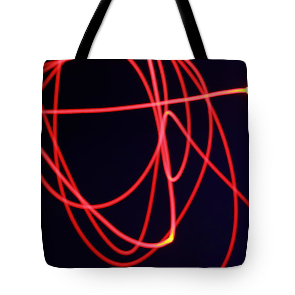Light Tote Bag featuring the photograph Fiery Red Light Strings by Mike M Burke