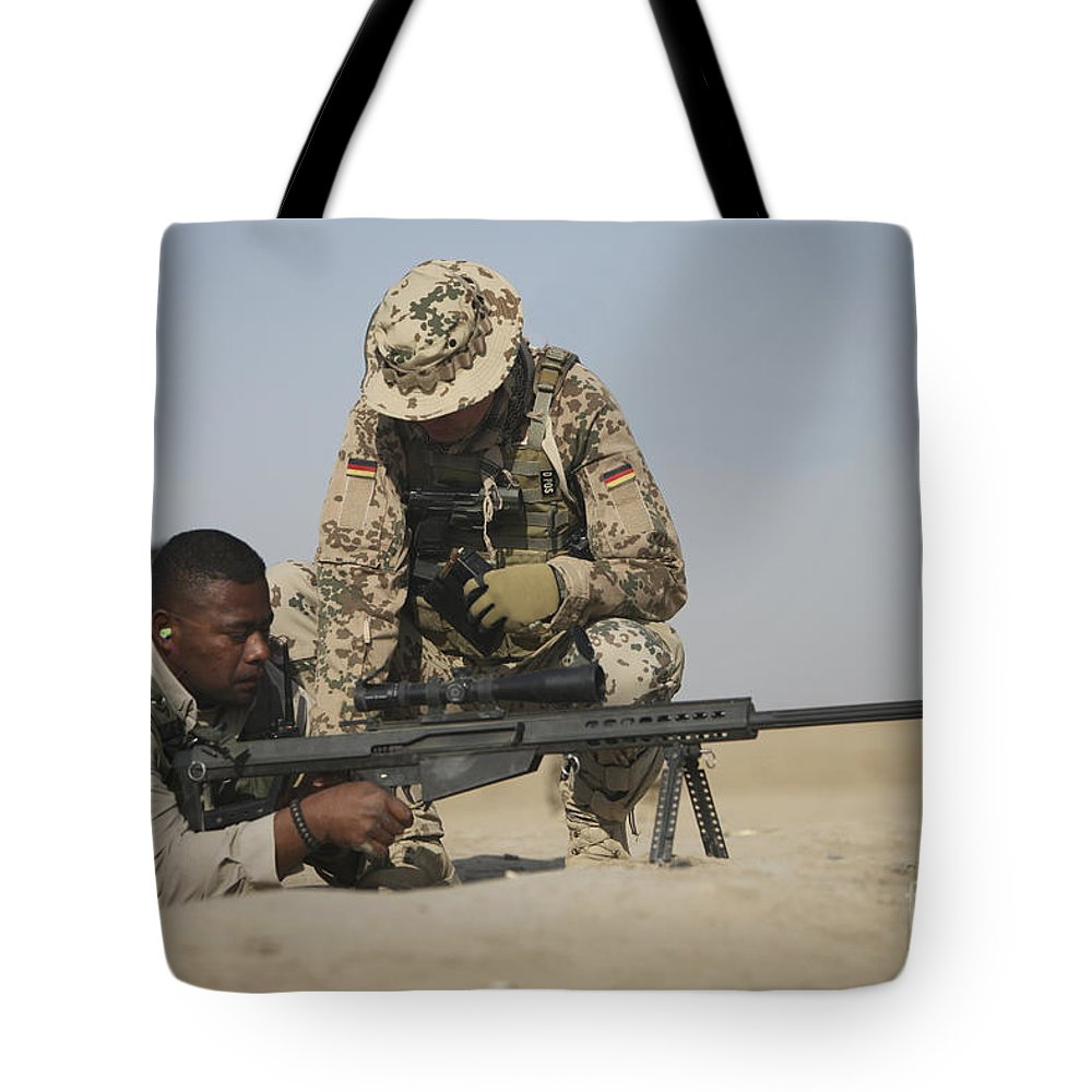 Operation Enduring Freedom Tote Bag featuring the photograph Fijian Contractor Clearing His Barrett by Terry Moore