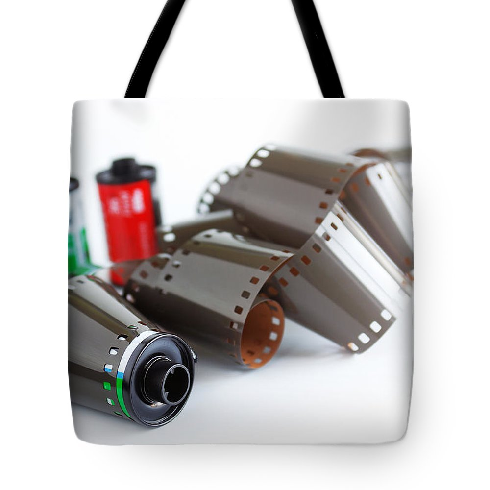 35mm Tote Bag featuring the photograph Film And Canisters by Carlos Caetano