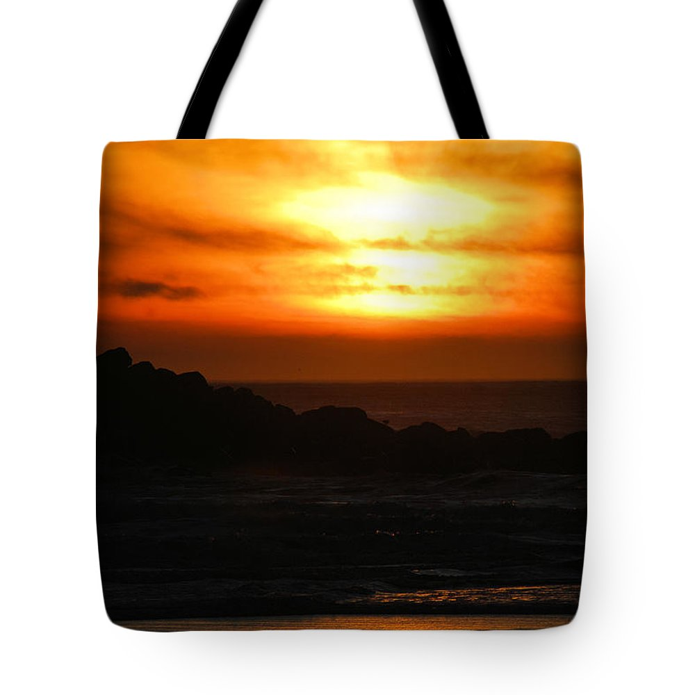 Sunset Tote Bag featuring the photograph Fishing Vessel At Sunset by Michael Merry