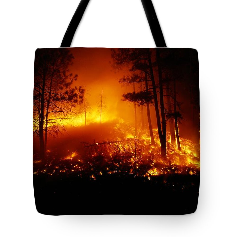 united States Tote Bag featuring the photograph Flames From A Forest Fire Light by Raymond Gehman