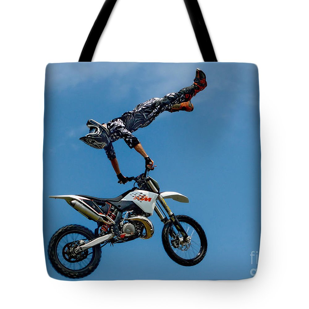 Motorcycle Tote Bag featuring the photograph Flying High Motorcyle Tricks by Andrea Kollo