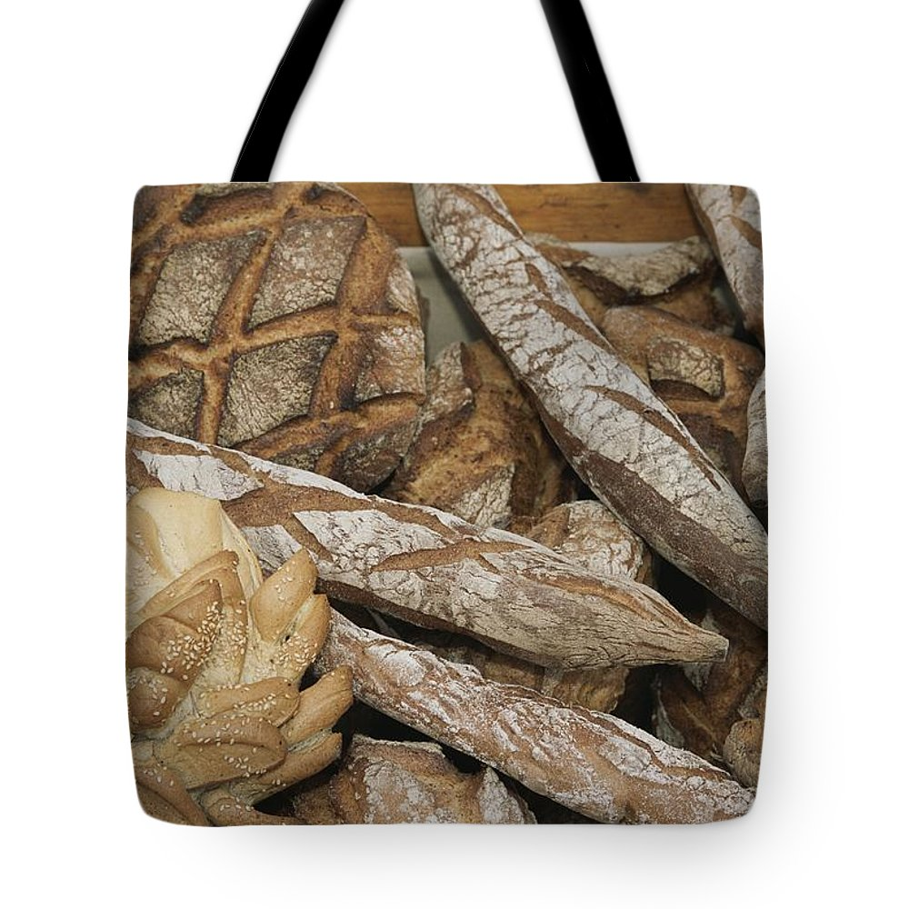 Europe Tote Bag featuring the photograph French Breads At A Bazaar In Provence by Nicole Duplaix
