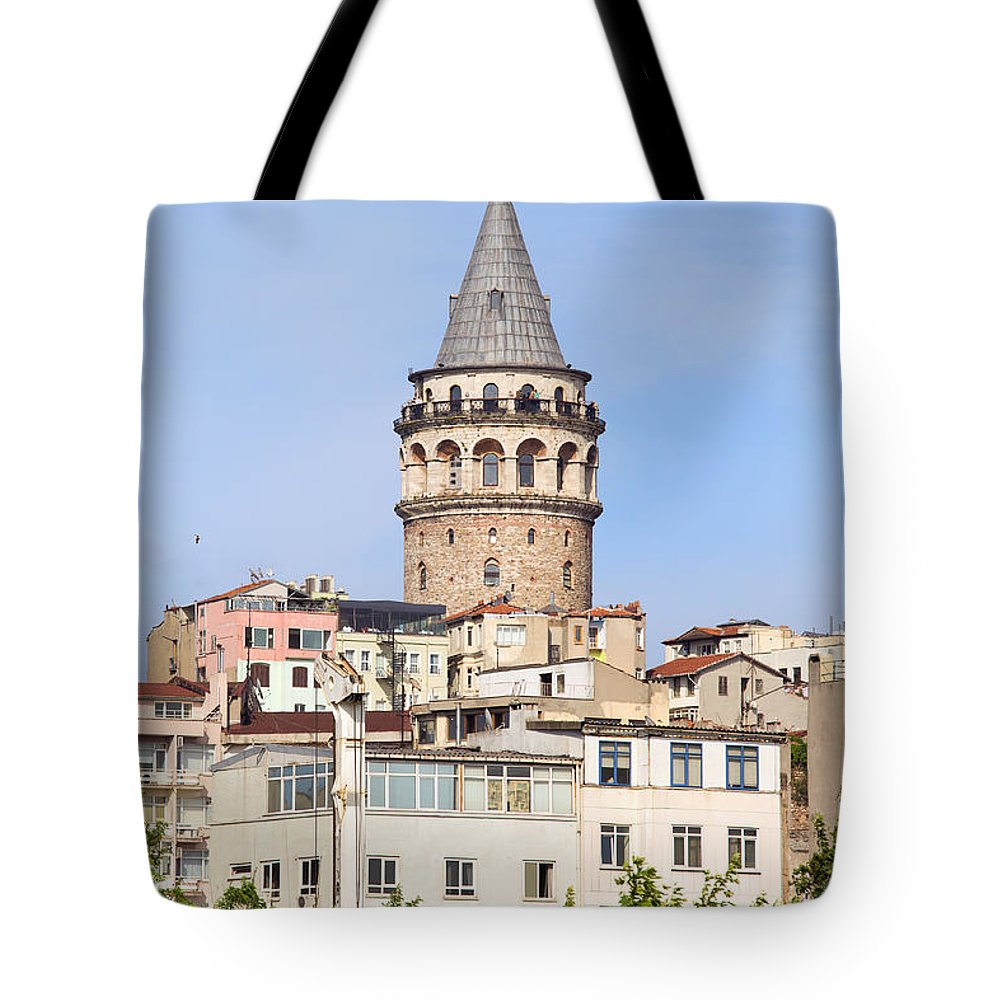 Galata Tote Bag featuring the photograph Galata Tower In Istanbul by Artur Bogacki