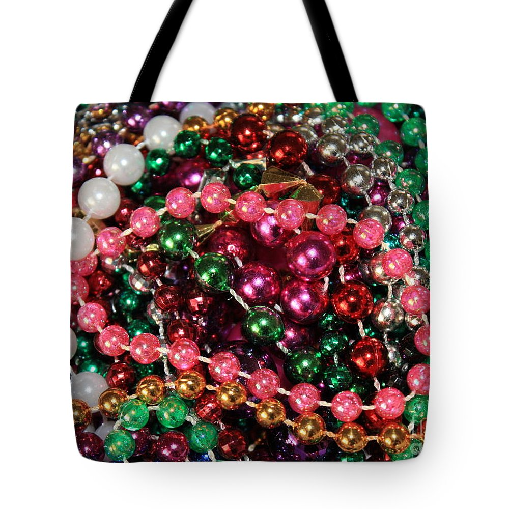 407f4089cdb0 Tampa Tote Bag featuring the photograph Gasparilla Beads 2 by Carol Groenen