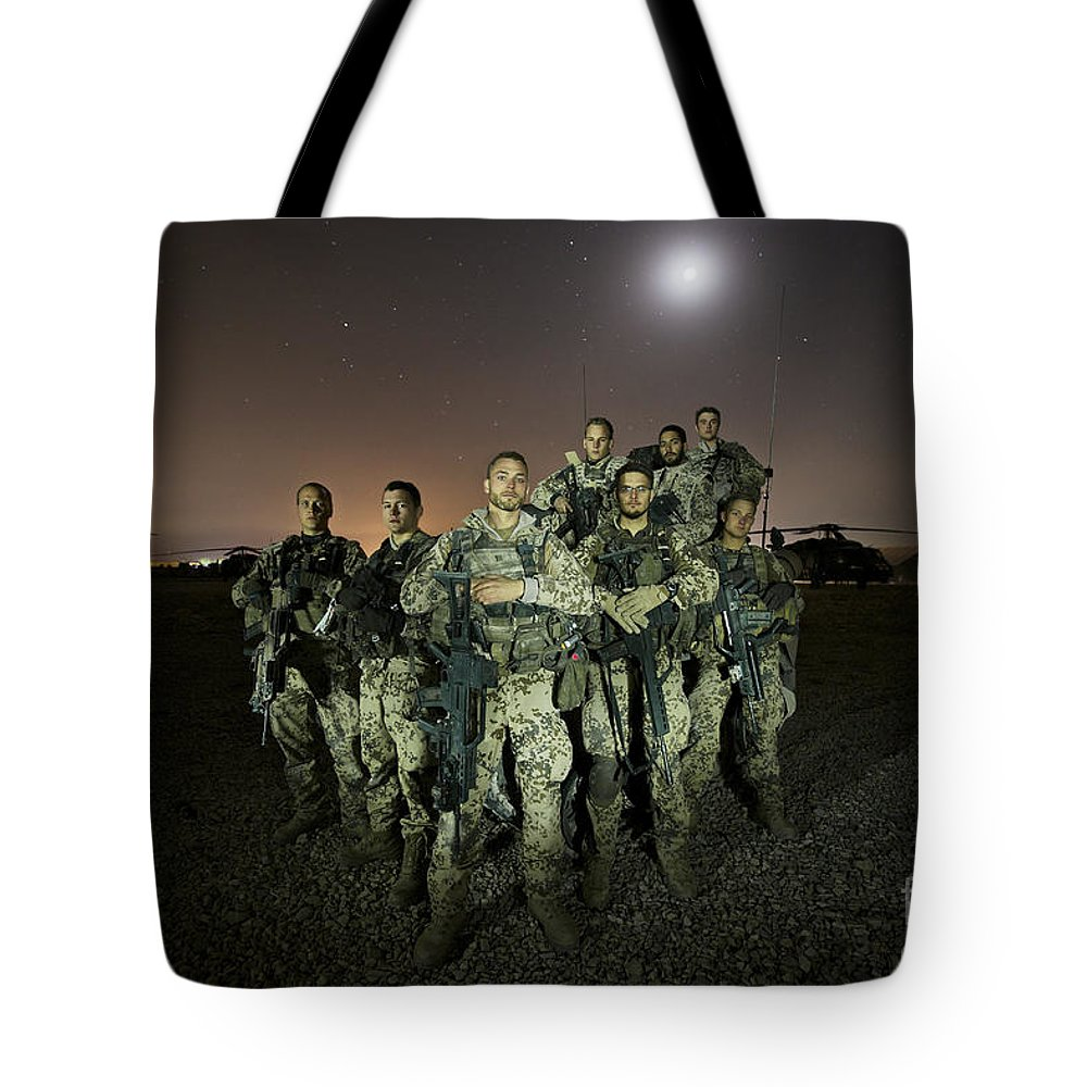 Provincial Reconstruction Team Tote Bag featuring the photograph German Army Crew Poses by Terry Moore