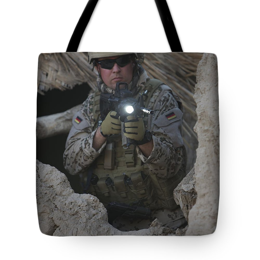 Operation Enduring Freedom Tote Bag featuring the photograph German Army Soldier Armed With A M4 by Terry Moore