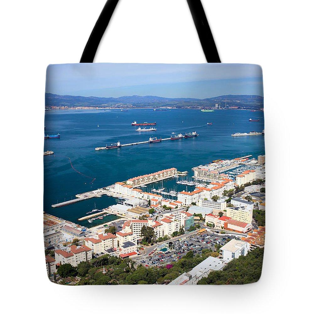 Gibraltar Tote Bag featuring the photograph Gibraltar Town And Bay by Artur Bogacki