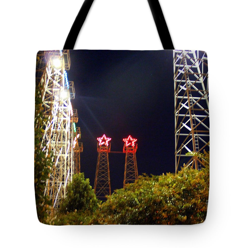 Kilgore Oil Derricks Tote Bag featuring the photograph Glimpse Of The Derricks In Kilgore by Kathy White