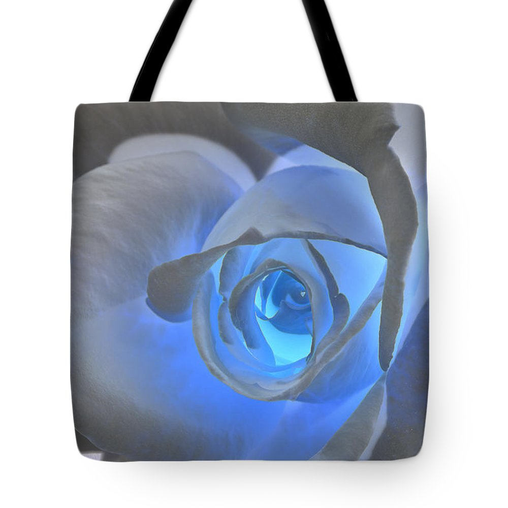Rose Tote Bag featuring the photograph Glowing Blue Rose by Phyllis Denton