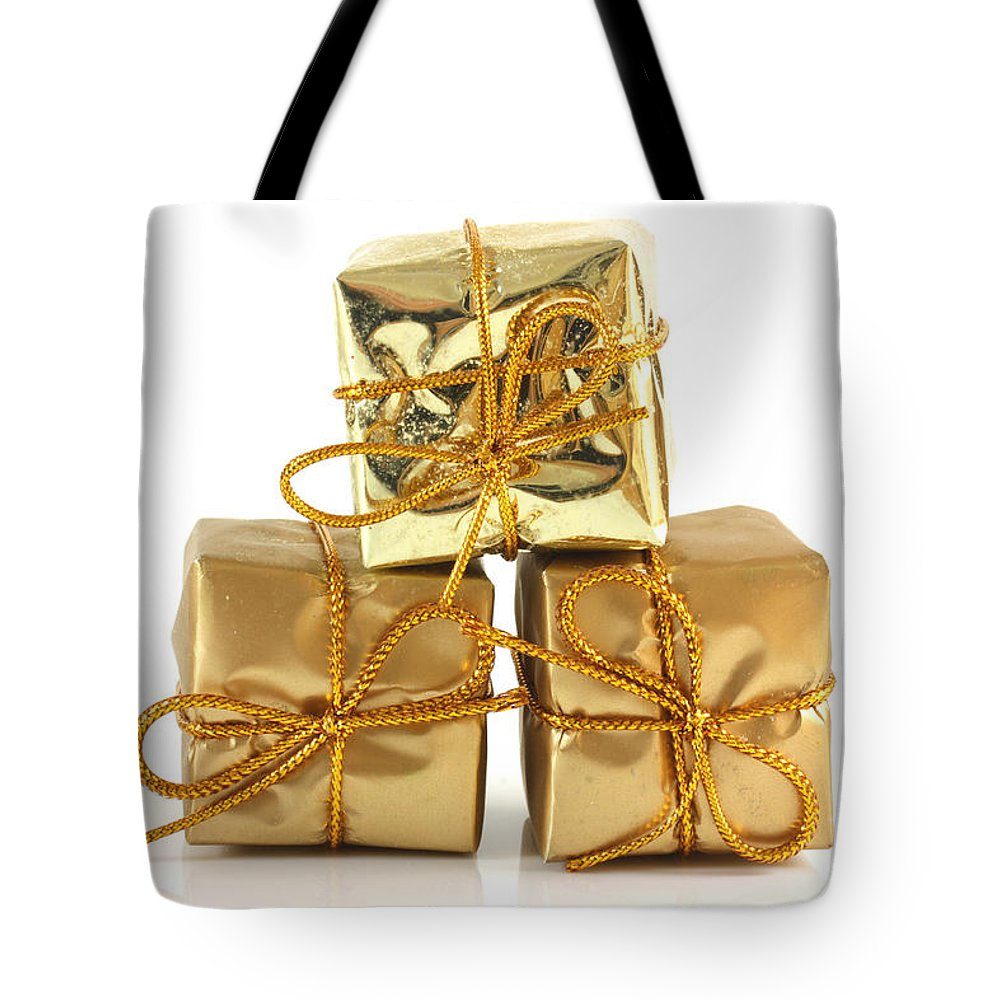 Anniversary Tote Bag featuring the photograph Gold Wrapped Parcels by Simon Bratt Photography LRPS