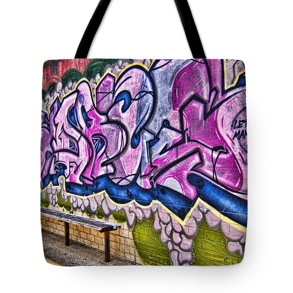 Graffitti Tote Bag featuring the photograph Graffitti-lets Gambl Make Dollars by Douglas Barnard