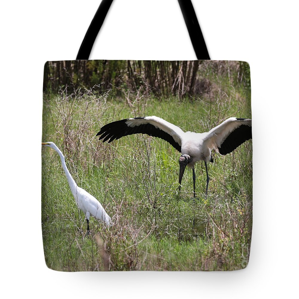 Great Egret Tote Bag featuring the photograph Great Egret And Wood Stork In The Marsh by Carol Groenen