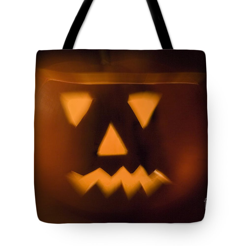 Autumn Tote Bag featuring the photograph Halloween Pumpkin by Alex Rowbotham