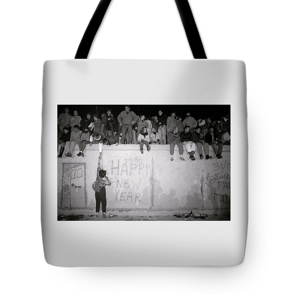 Berlin Wall Tote Bag featuring the photograph Freedom At The Berlin Wall by Shaun Higson