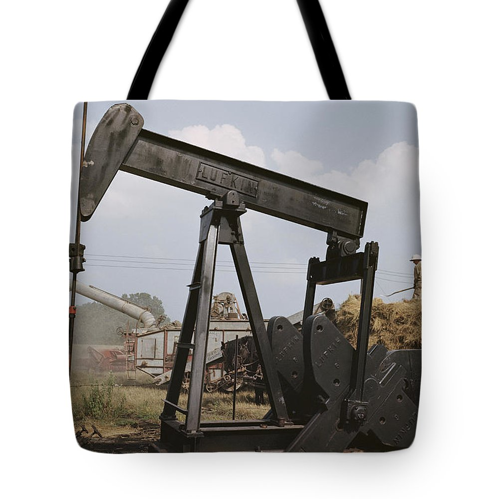 oil Industry And Production Tote Bag featuring the photograph Harvestors Trash Fields While Black by B. Anthony Stewart