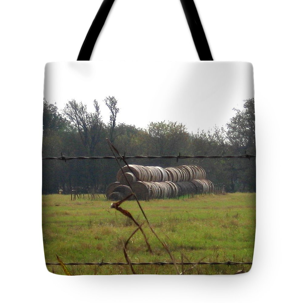 Tote Bag featuring the photograph Hay Lined Up by Amy Hosp