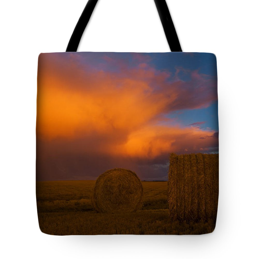 Agriculture Tote Bag featuring the photograph Heavy Clouds And Hay Bales by Mike Grandmailson