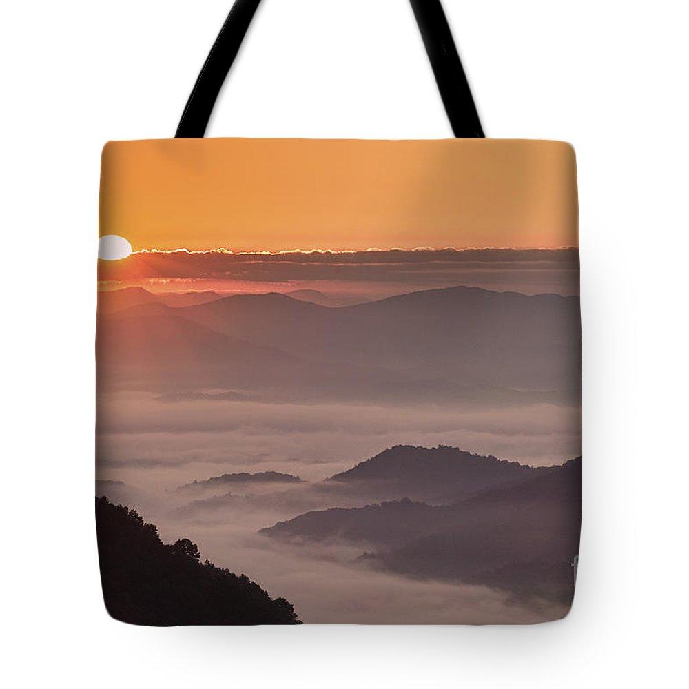 Sunrise Tote Bag featuring the photograph Here Comes The Sun. by Itai Minovitz