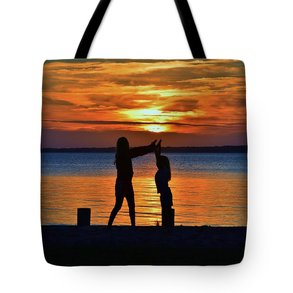 Sun Tote Bag featuring the photograph High 5 by William Bartholomew