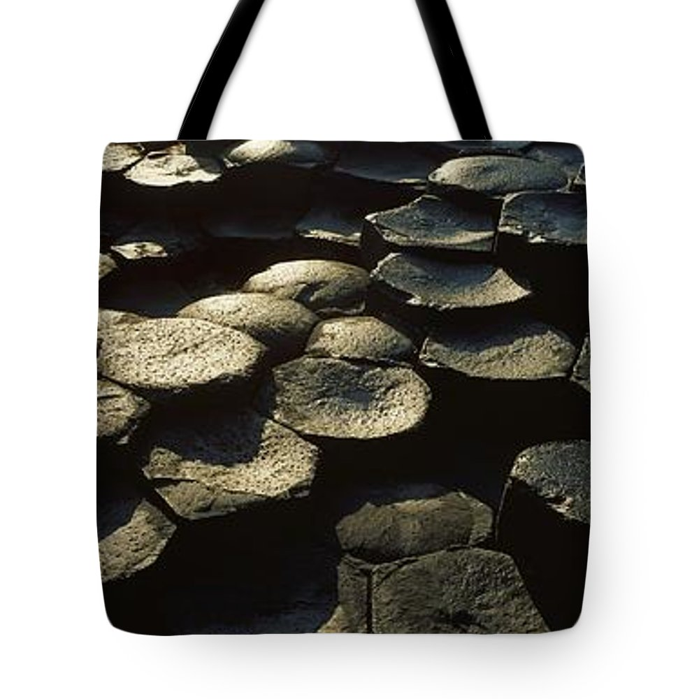 Basalt Tote Bag featuring the photograph High Angle View Of Basalt Rocks, Giants by The Irish Image Collection
