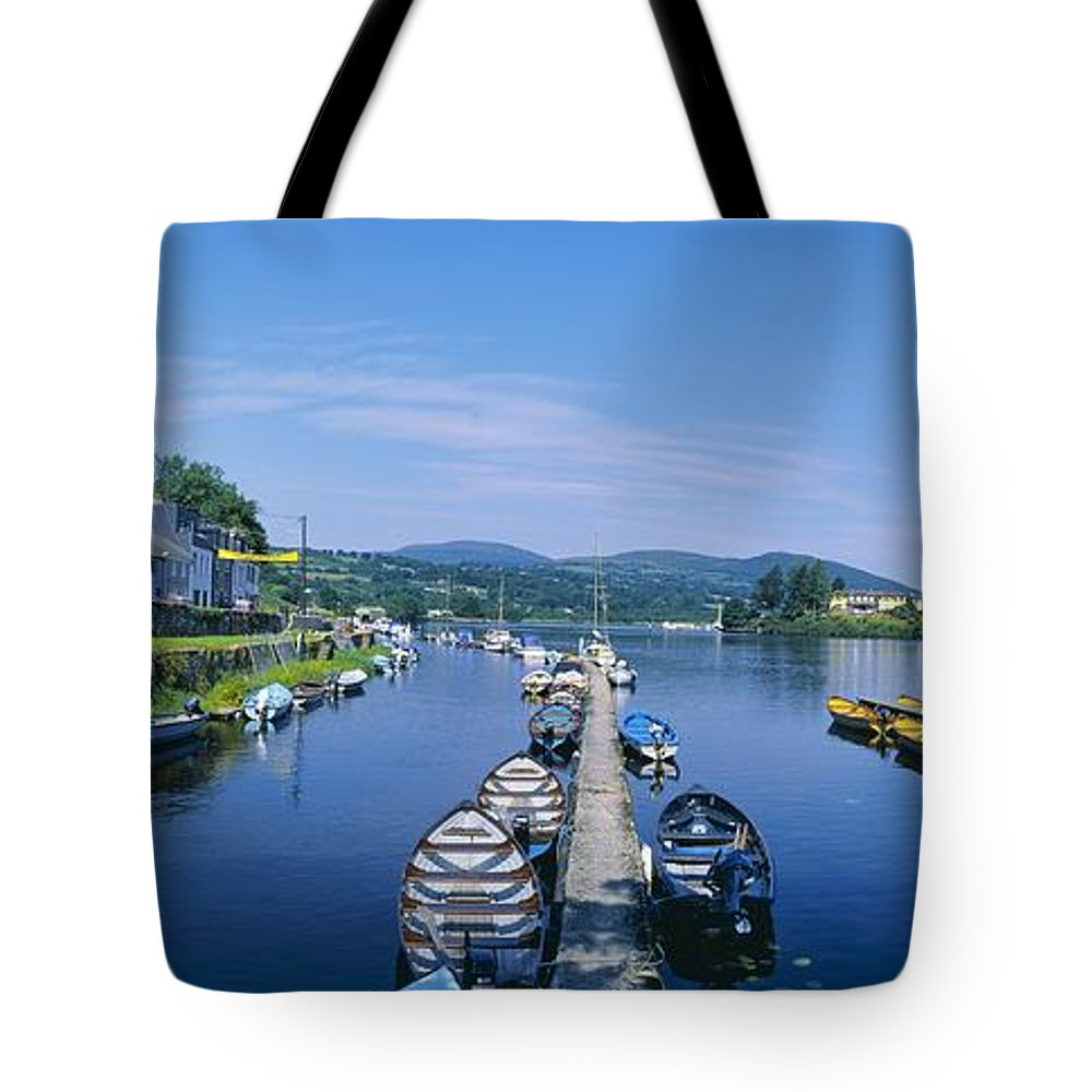 Boat Tote Bag featuring the photograph High Angle View Of Rowboats In The by The Irish Image Collection