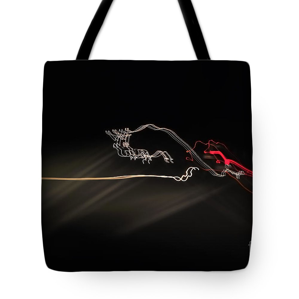 Abstract Photographs Tote Bag featuring the photograph Highway Lighting Effects-red Bull by Evmeniya Stankova