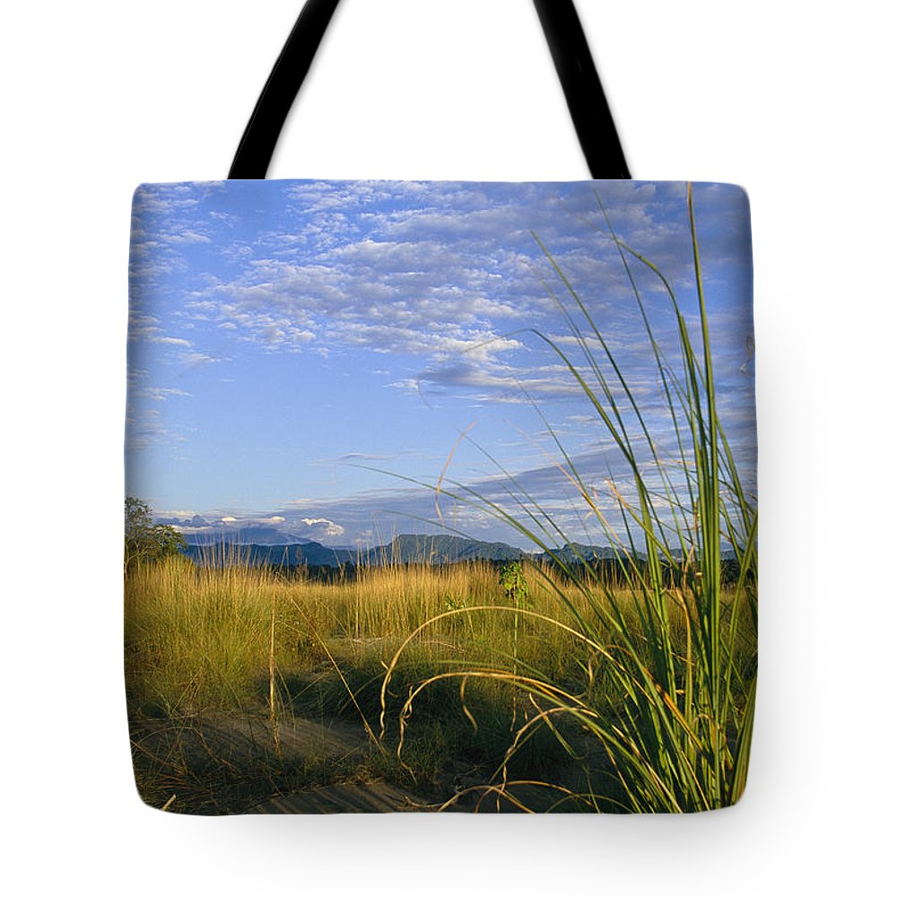 Asia Tote Bag featuring the photograph Hills Loom In The Distance by Steve Winter