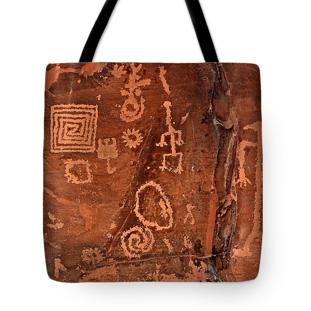 Petroglyphs Tote Bag featuring the photograph History In Stone by Phyllis Denton
