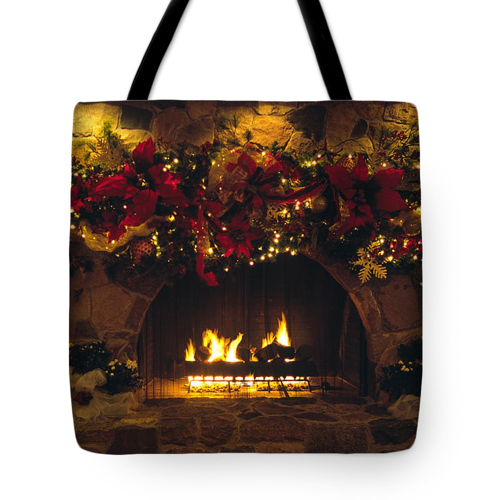 Stone Fireplace With Christmas Decorations And Lights Tote Bag featuring the photograph Holiday Hearth by Sally Weigand