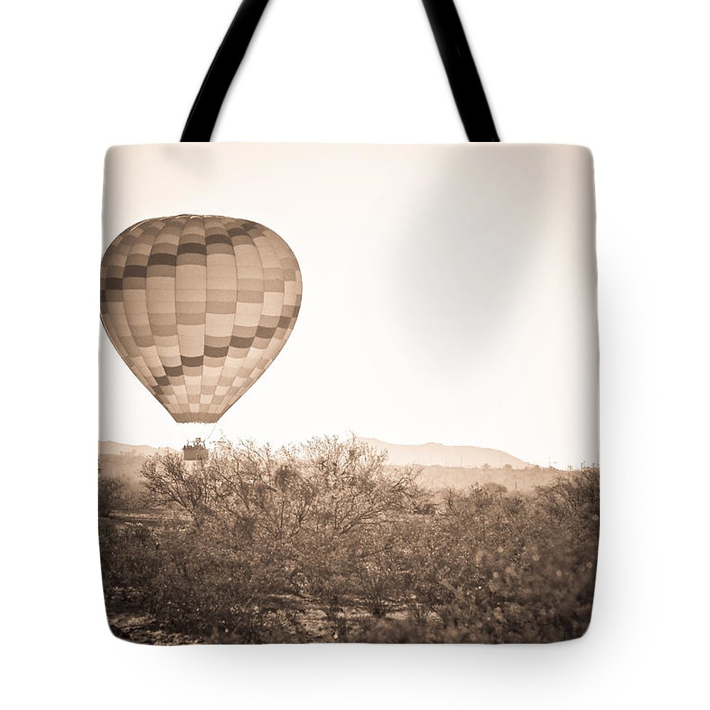 Arizona Tote Bag featuring the photograph Hot Air Balloon On The Arizona Sonoran Desert In Bw by James BO Insogna