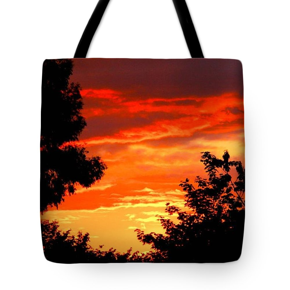 Sunset Tote Bag featuring the photograph Hot Metal Sky by Anthony Brito
