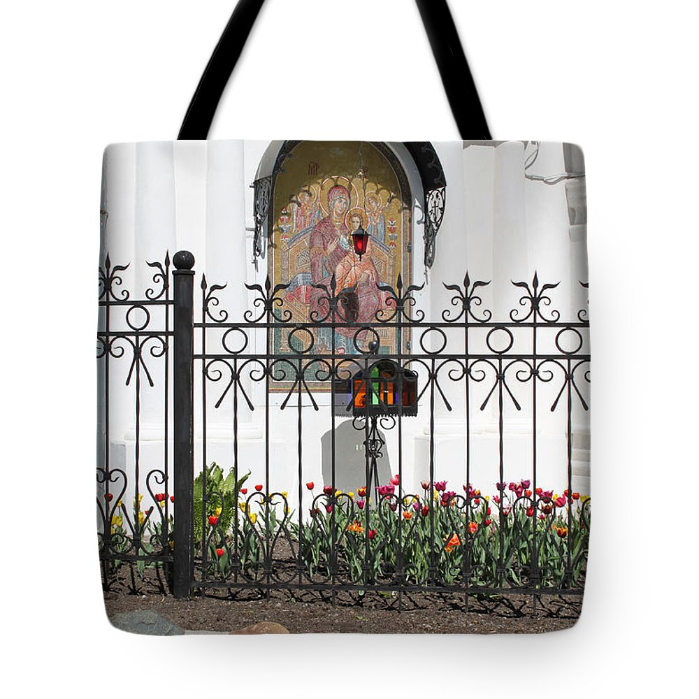 Church Tote Bag featuring the photograph In Front Of Church by Evgeny Pisarev