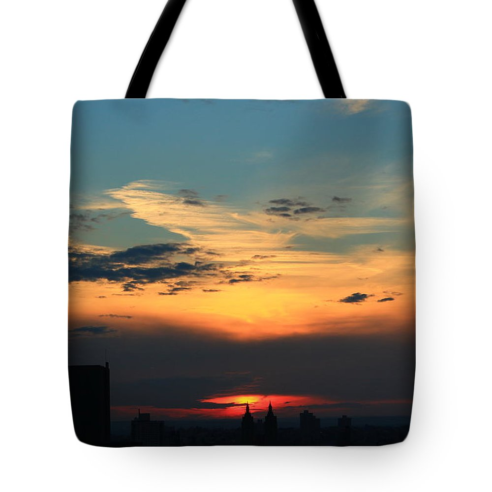 Sunset Tote Bag featuring the photograph In The Clouds by Catie Canetti