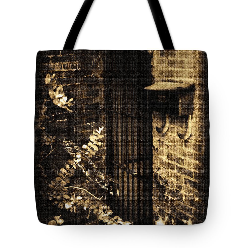 Antique Tote Bag featuring the photograph Iron Door Sepia by Kelly Hazel