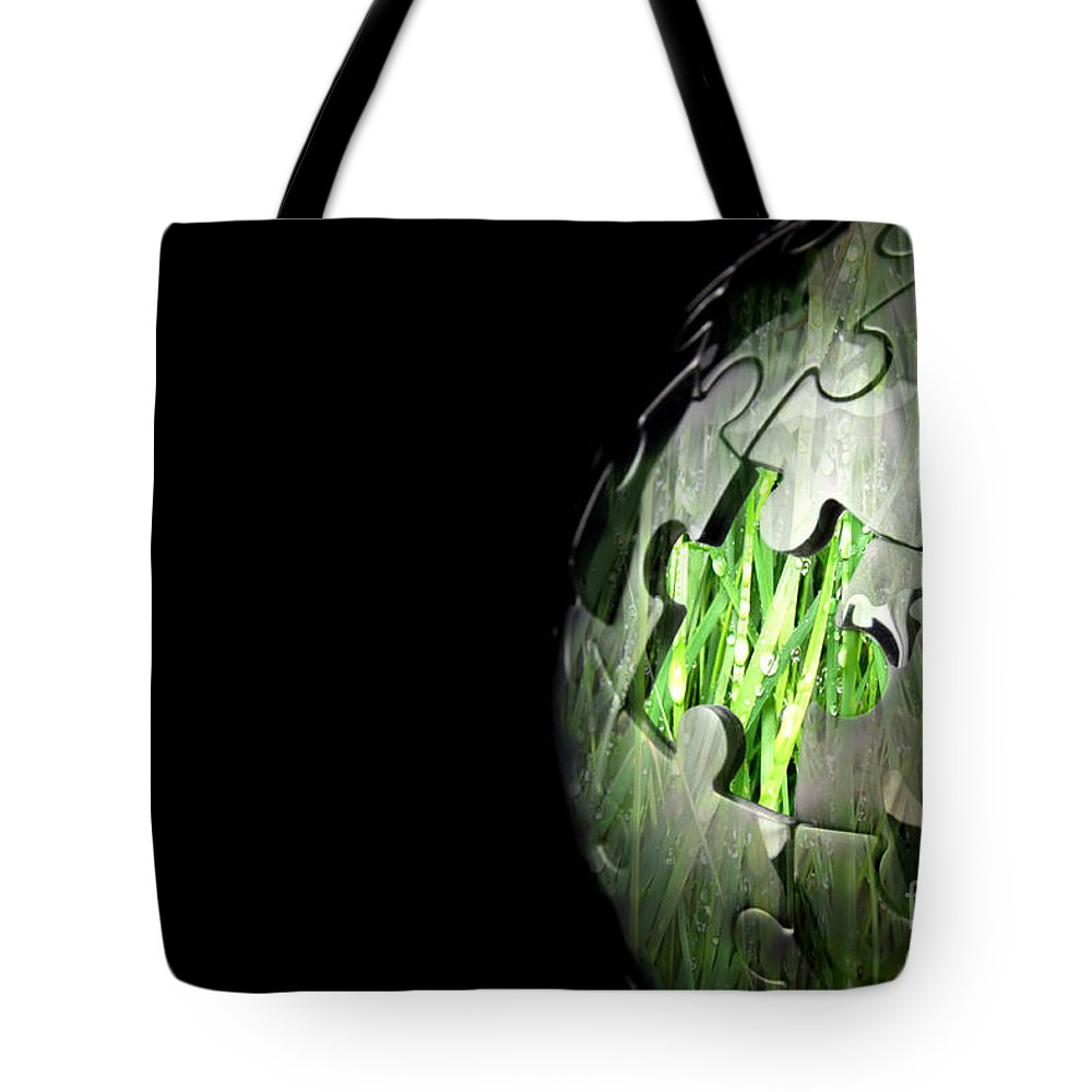 Global Tote Bag featuring the photograph Jigsaw Globe With Grass Inside by Simon Bratt Photography LRPS