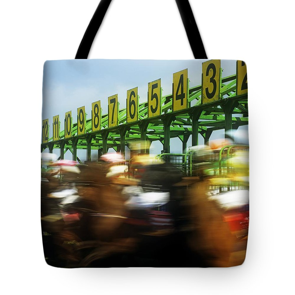 Beginnings Tote Bag featuring the photograph Jockeys Leaving Starting Gates by The Irish Image Collection