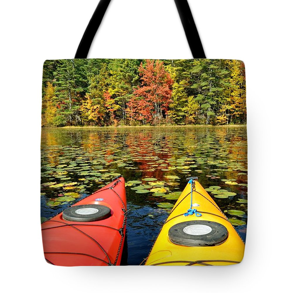 Kayak Tote Bag featuring the photograph Kayaks In The Fall by Rick Frost
