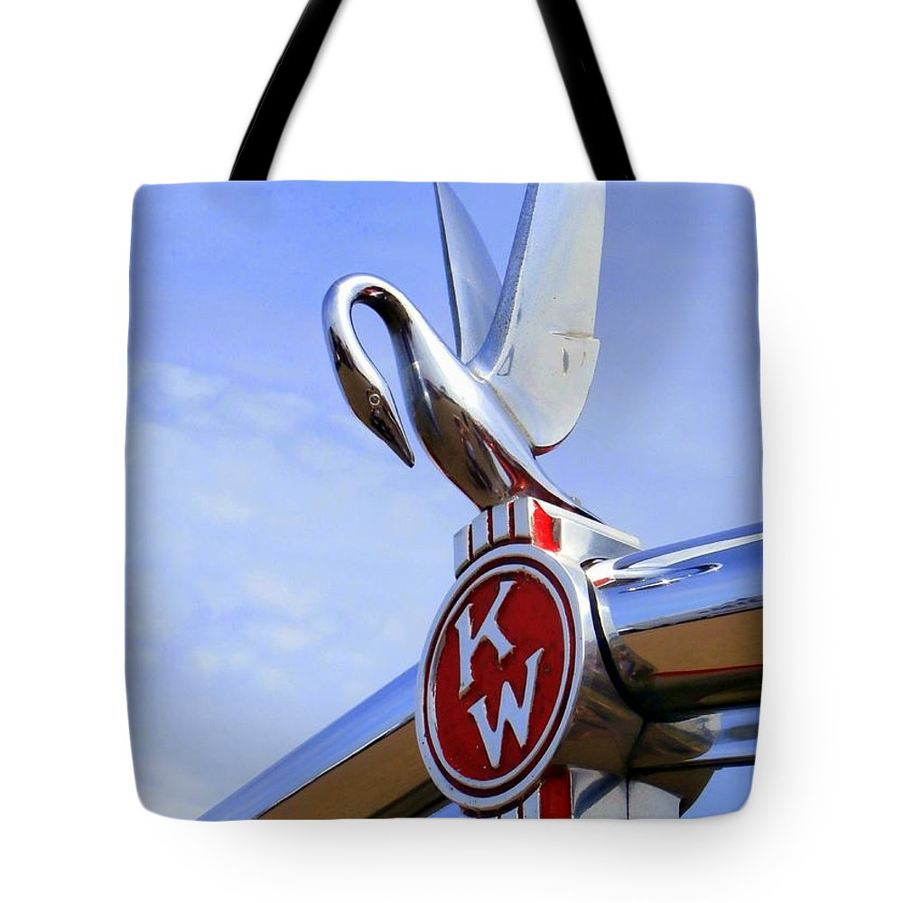 Swan Hood Ornament Tote Bag featuring the photograph Kenworth Insignia And Swan by Karyn Robinson