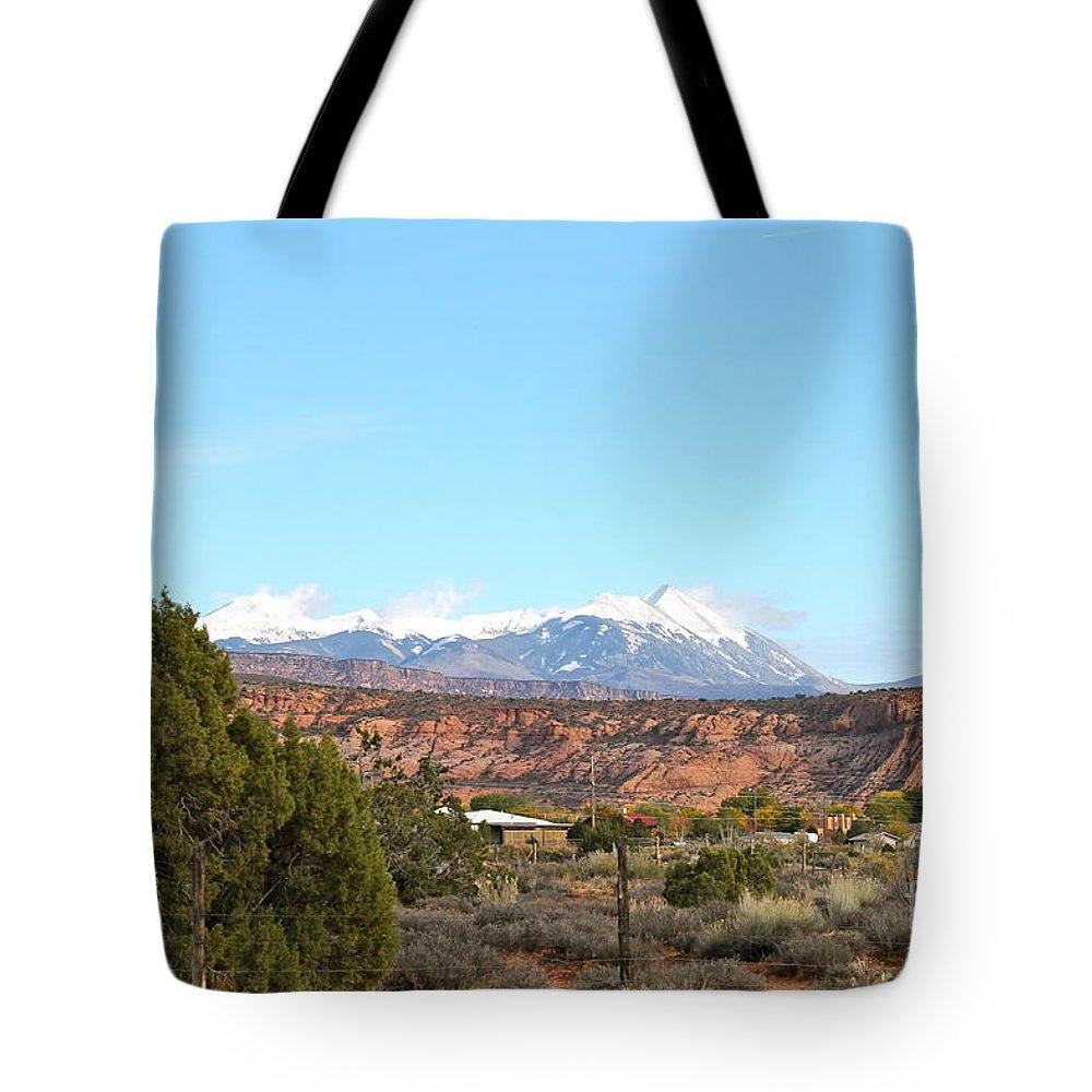 La Sal Tote Bag featuring the photograph La Sal Mountains by Pamela Walrath