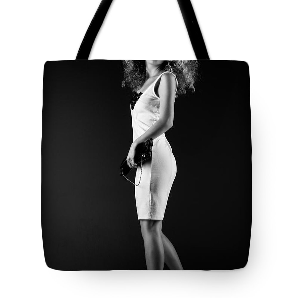 Ralf Tote Bag featuring the photograph Lady With Curly Hair Bw by Ralf Kaiser