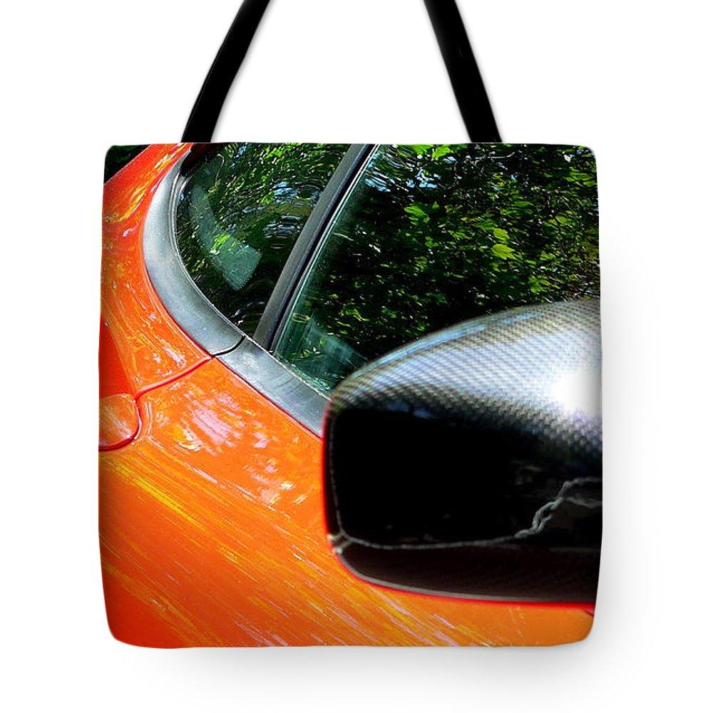 Lamborghini Tote Bag featuring the photograph Lamborghini Mirror And Intake by Jeff Lowe