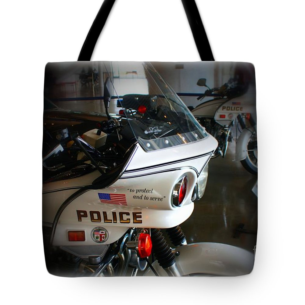 Los Angeles Tote Bag featuring the photograph Lapd Motorcycle by Tommy Anderson