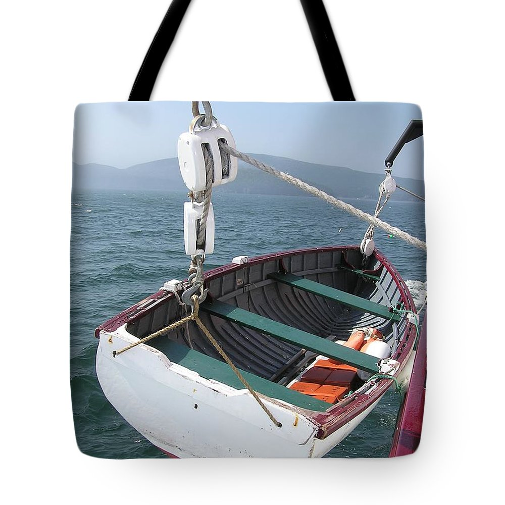 Lifeboat Tote Bag featuring the photograph Lifeboat From The Schooner Margaret Todd by Sven Migot