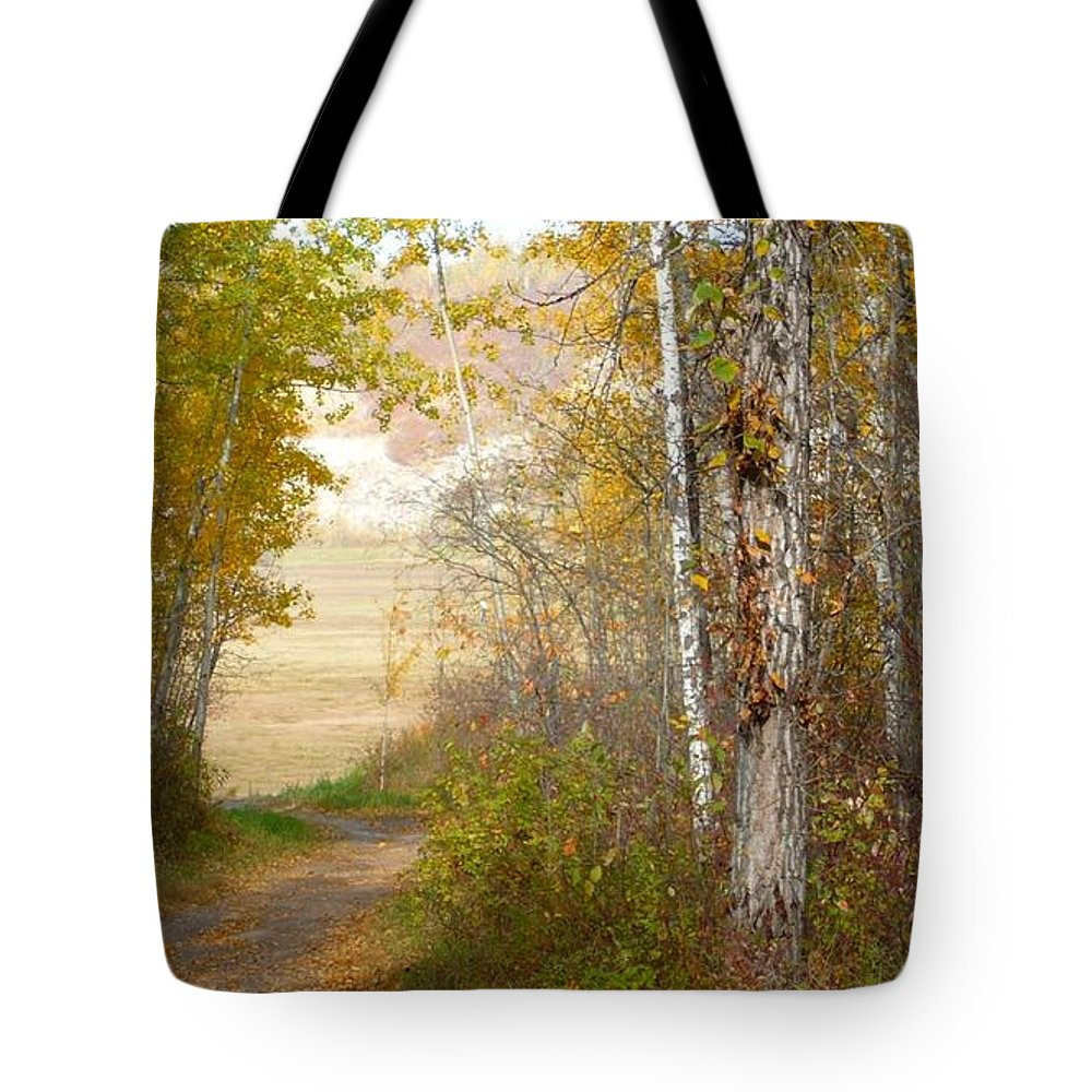 Nature Tote Bag featuring the photograph Light At The End by Jim Sauchyn