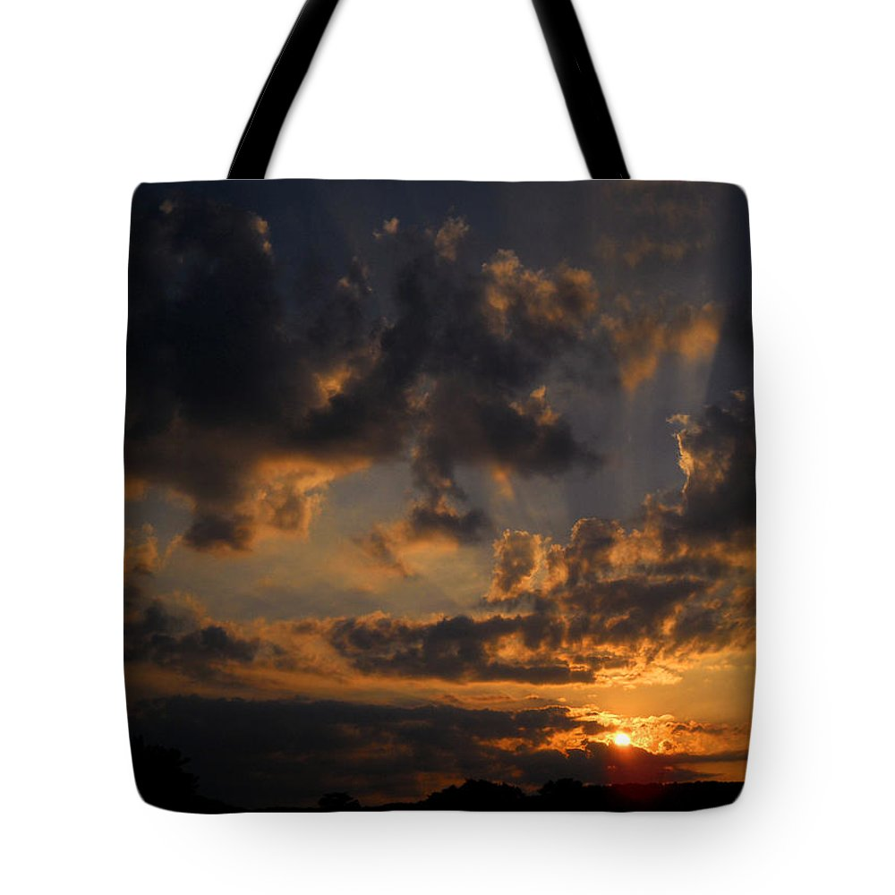Sunset Tote Bag featuring the photograph Light in the Darkness by Amanda Jones